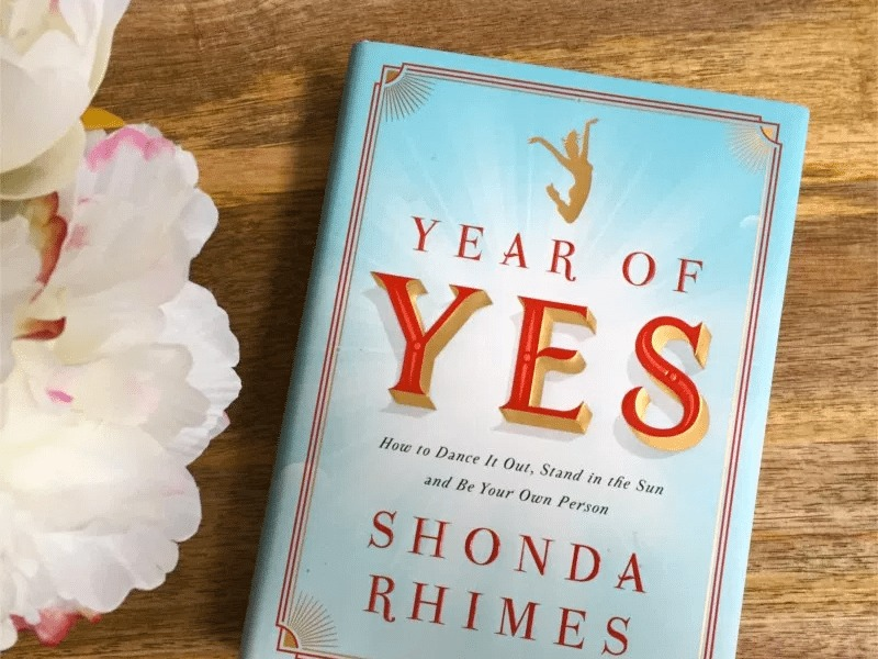 A blue book entitles Year of Yes: How to Dance It Out, Stand in the Sun and BE Your Own Person Shonda Rhimes